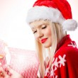 Beautiful blonde young woman in red hat with opened gift box — Stock Photo