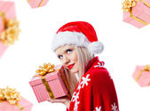 Beautiful blonde woman holding christmas gift in red hat — Stock Photo
