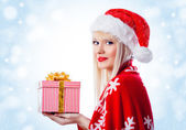 Pretty woman with christmas gift in red hat — Stock Photo