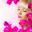 Stock Photo: Pretty blonde young womwith flowers