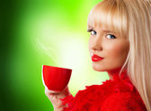 Beautiful blonde woman with coffee or tea — Stock Photo
