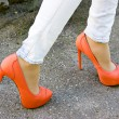 Stock Photo: Orange shoes outdoors