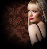 Beautiful blonde woman in luxury fur coat — Stock Photo