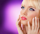 Beautiful blonde woman with manicure and purple makeup — Stock Photo