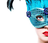 Beautiful girl in blue carnival mask — Stock Photo