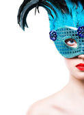 Beautiful young woman in blue carnival mask — Stock Photo