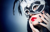 Girl in black carnival mask with manicure — Stock Photo
