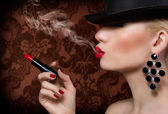 Beautiful blonde girl with cigarette and red lips — Stock Photo