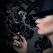 Pretty blonde girl with cigarette and red lips — Stock Photo #25319057