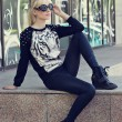 Pretty blonde girl in pullover with tiger print — Foto de stock #25756151