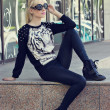 Pretty blonde girl in pullover with tiger print — Stok Fotoğraf #25756151