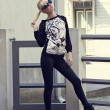 Pretty blonde girl in pullover with tiger print — Stok Fotoğraf #25756163