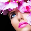 Stock Photo: Beautiful girl with flowers and perfect makeup