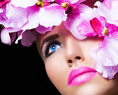 Beautiful girl with flowers and perfect makeup — Stock Photo