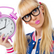 Blonde girl with clock — Stock Photo