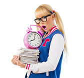 Surprised girl holding books and clock — Stock Photo