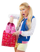 Surprised girl holding gift — Stock Photo