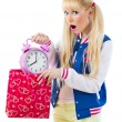 Surprised girl holding clock — Stock Photo