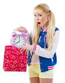 Surprised girl holding clock — Stock Photo
