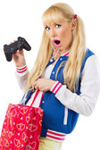 Surprised girl with game joystick — Stockfoto