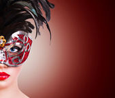 Girl in red carnival mask — Stock Photo