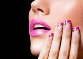 Beautiful girl with pink lips and nails — Stock Photo
