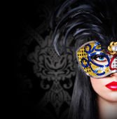 Beautiful girl in carnival mask with red lips — Stock Photo