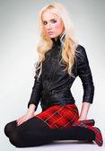 Beautiful fashionable girl in skirt — Stock Photo