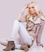 Beautiful fashionable girl in jacket — Stock Photo