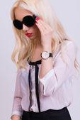 Beautiful blonde model with sunglasses — Stock Photo