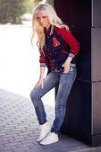 Beautiful blonde girl in posing — Stock Photo