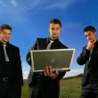 Group of business men watching laptop — Stock Photo #13222327