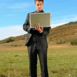 Man holding a laptop — Stock Photo #13222436