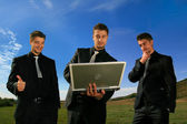 Group of business men watching laptop — Stock Photo