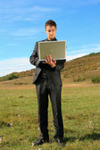 Man holding a laptop — Stock Photo
