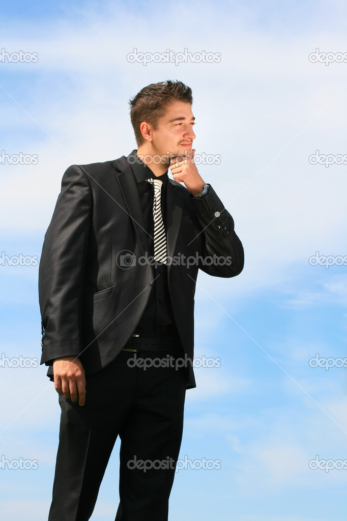 Business man making decisions about future moves.  Stock Photo #13222492