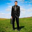 Businessman in the field — Stock Photo