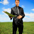Stock Photo: Businessman offering a folder