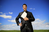 Businessman holding a folder — Stock Photo