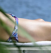 Woman sunbathe — Stock Photo
