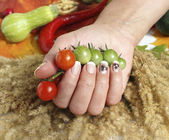 Cherry tomatoes and a woman hand — Foto de Stock