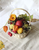 Basket with autumn goodies — Stock Photo