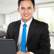 Young business man with a laptop — Foto de Stock   #11244986