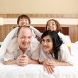 Happy family in the bed — Stock Photo #11851290