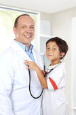 Doctor have fun with his patient — Stock Photo