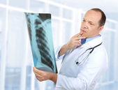 Doctor looking at x-ray — Stock Photo