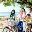 Постер, плакат: Happy family with bikes