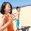 Kids running in the beach — Stock Photo #12637470