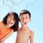 Kids having fun in sunny day — Stock Photo