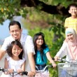 Happy family with bikes — Stock Photo #12637538